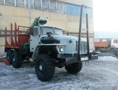 Лесовоз Урал 43204 с манипулятором Атлант-С 90 и роспуском