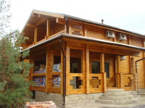 Design, construction of wooden houses from glued beams