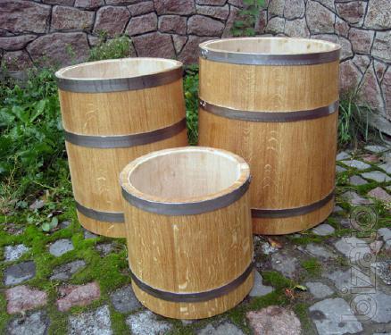Barrel oak, tubs of pickles, pickled cone and round shape. Barrel under salting.