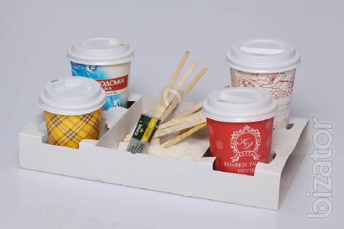 Paper cups for coffee with logo and paper plates.