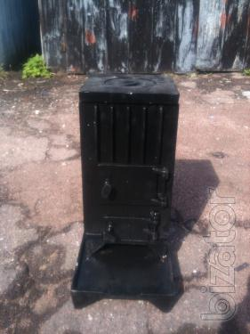The cast iron stove. Stove 1 burner. Oven collapsible. New