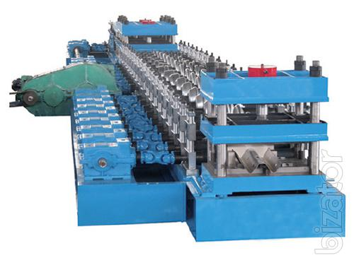 Roll forming machine to produce road barriers
