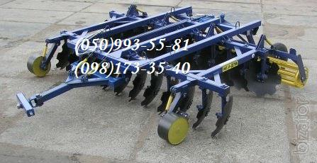 Disc harrow Agde 4.5 N under the tractor T150