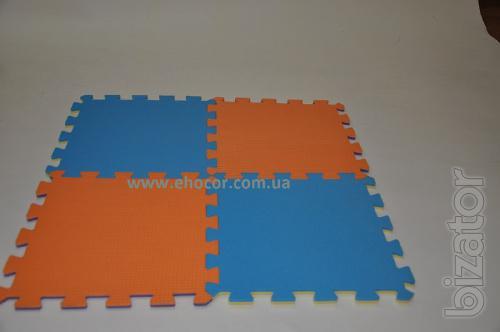 Soft floor in the nursery. Children's rugs-puzzle. Flooring