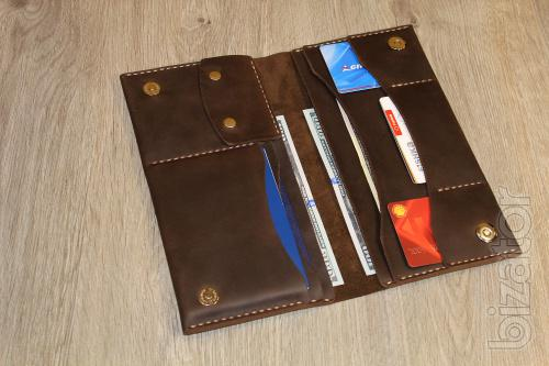 A travel organizer, clutch, wallet, purse 3 in 1.