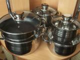A set of stainless steel cookware made in Germany bottom 9-ply and Hairdryer