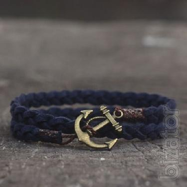 Braided suede bracelet on the arm. Men's bracelet with anchor Port Royal