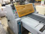 Industrial laminating machine YDFM-920 used, in excellent condition.