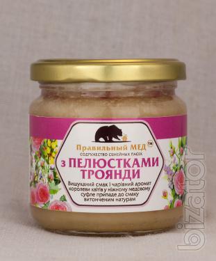 Honey with petals of a tea rose. Dessert based on cream-honey