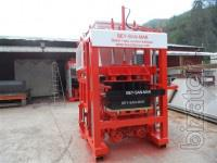 Machine for the production of paving tiles